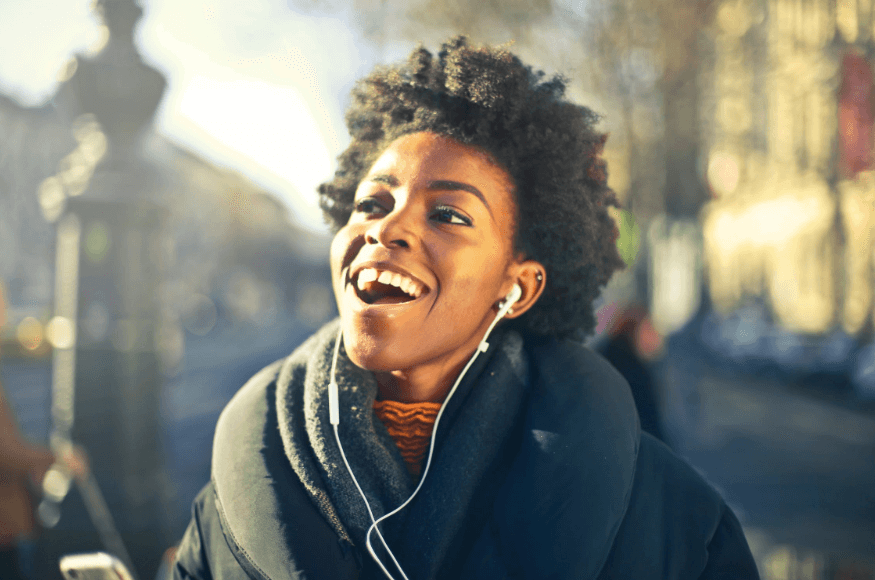 spotify student discount: close up photo of a woman listening to music