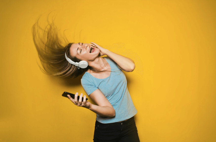 spotify student discount: photography of woman listening to music
